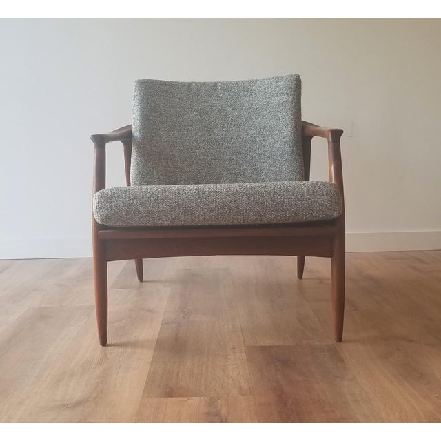 Newly upholstered and restored 1950s lounge chair (model 72-c) designed by Folke Ohlsson for DUX. Model 72-c consists of...