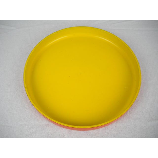 Op Art round melamine serving tray of vibrant canary yellow interior and orange exterior. Some scratches to melamine...
