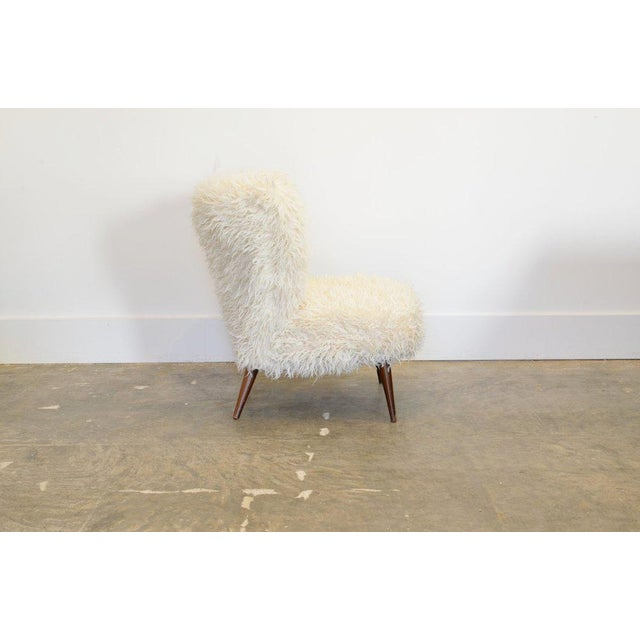 This listing is for a fluffy lounge chair in faux fur circa 1950's. The designer is unknown.