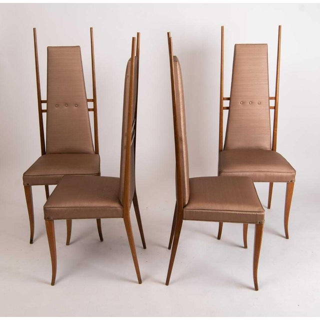 Incredible Gio Ponti-style dining chairs. Circa 1960's. Ready for new upholstery. Beautiful vintage condition. Definitely...