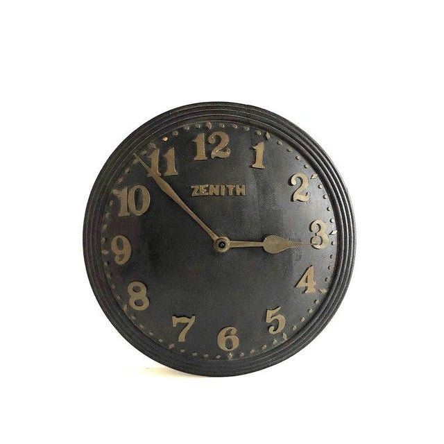 Made by Zenith in Switzerland, this vintage wall clock is an impressive piece measuring 14 inches in diameter. The large...