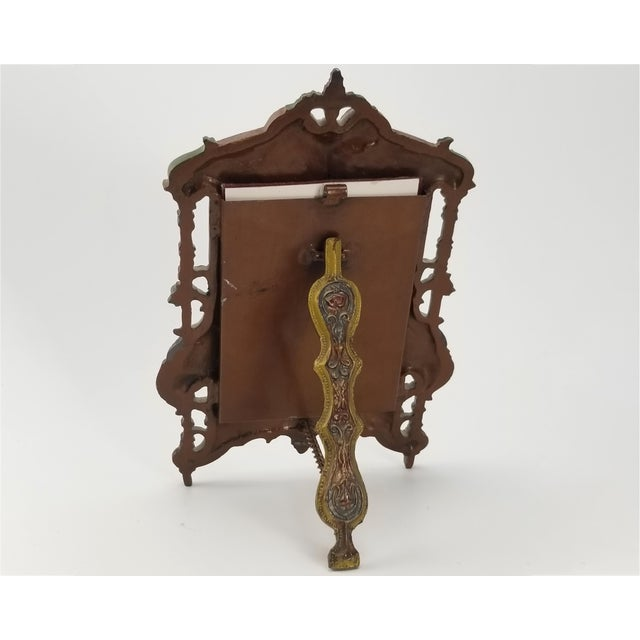 This frame is modeled and cast in the renaissance revival or Italianate style. The frame is made of very heavy cast iron....