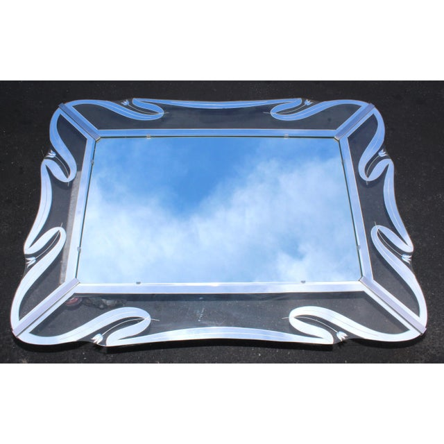 Stunning 1950s Mid-Century Modern, clear and mirror etched glass frame mirror with chrome hardware.