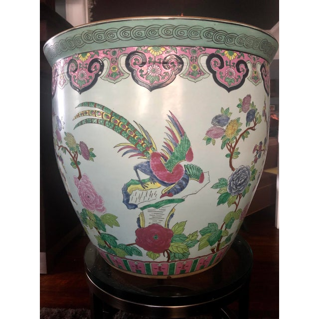 Large ornate Asian fishbowl planter with colorful nature scenery depicting birds, flowering trees, vines, and patterns. In...