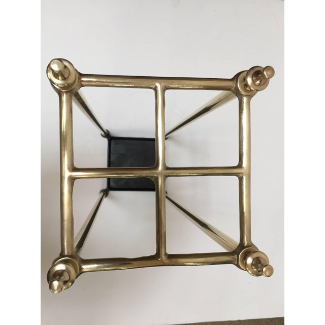 Victorian umbrella stand with a brass polished top divided into four sections to hold either walking sticks or umbrellas....