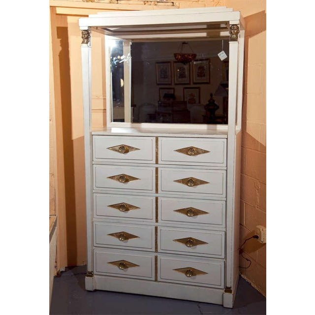 Charming French Empire style tall dresser with mirror vanity, circa 1960s by Grosfeld house, labeled on top drawer....