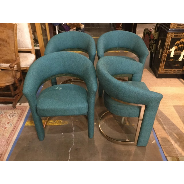 Four fantasticMilo Baughman for Carson vintage dining chairs. Newly recovered in a beautiful blue green and gold woven...