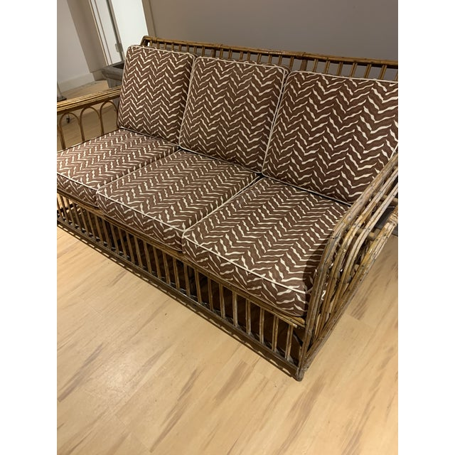 Stunning 1930's rattan sofa.. .. so comfortable!!!! Chic chocolate and white chevron pattern fabric, which can easily be...