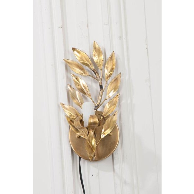 """A fabulous pair of French vintage gilt-brass """"laurel leaf"""" single-arm sconces, c. 1970's, each light fashioned to appear..."""