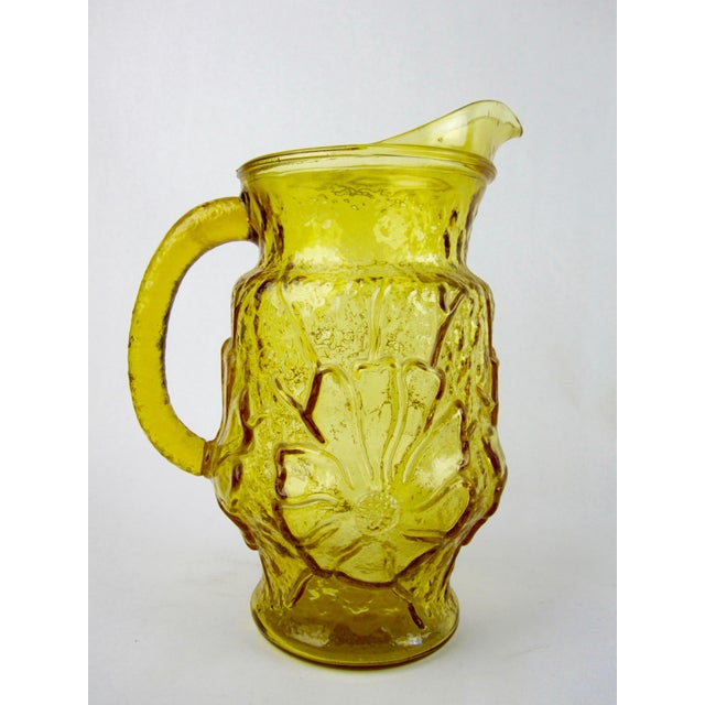 """Vintage 60's -1970's Anchor Hocking """"Rain Flower"""" pattern pressed glass pitcher in amber yellow. In excellent condition,..."""