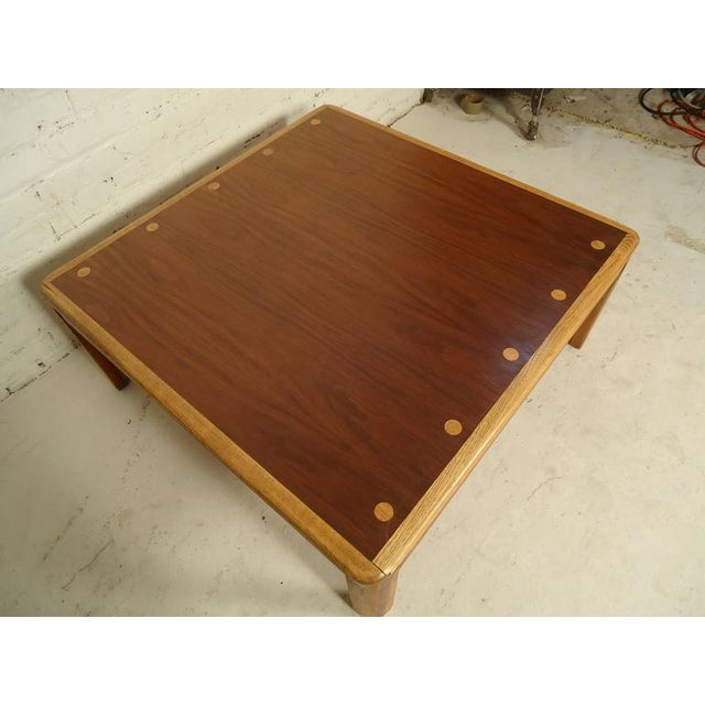 Mid-Century Modern coffee table by Lane with rich walnut grain and oak legs and matching inlay dots. (Please confirm item...