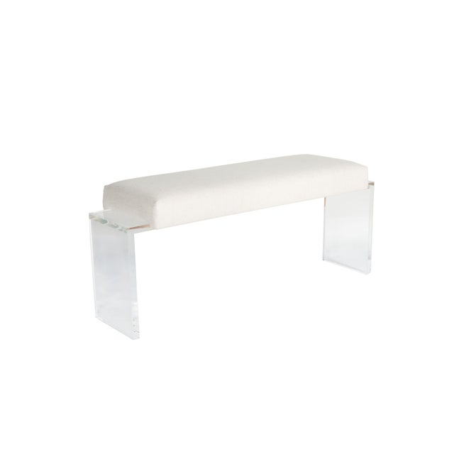 Lucite frame upholstered bench.One inch thick lucite base supports upholstered top. COM requirements: 2 yards 5% up-charge...