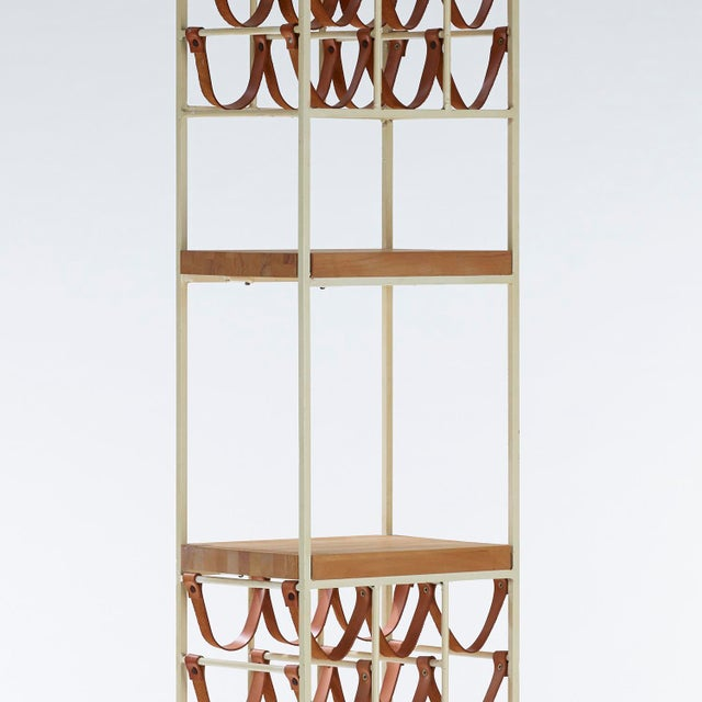 """Enameled iron, leather, and wood wine rack by Arthur Umanoff for Shaver Howard and Raymor circa 1950s Measures 66.5"""" high,..."""