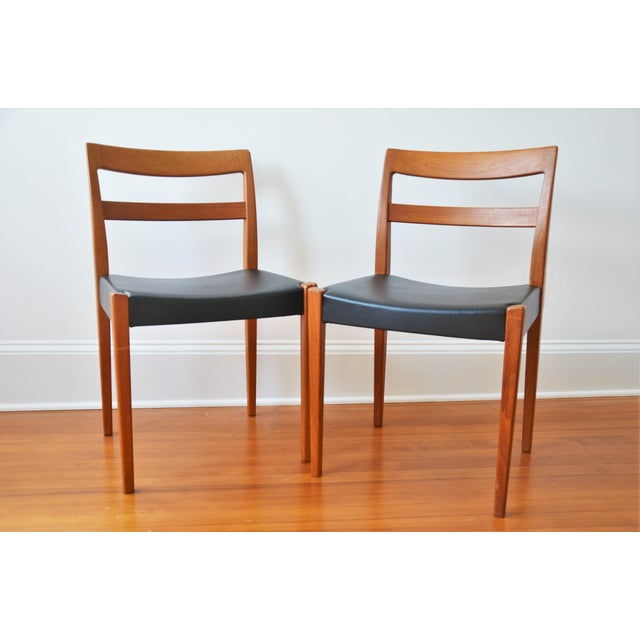 A great pair of Swedish Mid-Century Modern dining chairs designed by Nils Jonsson for Troeds, Sweden. This dining chair is...