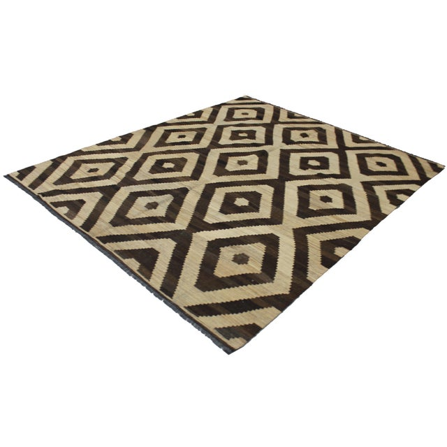 A beautiful modern kilim, handmade by Aara Rugs. New geometric design. This kilim is made of 100% wool, dyed with all...