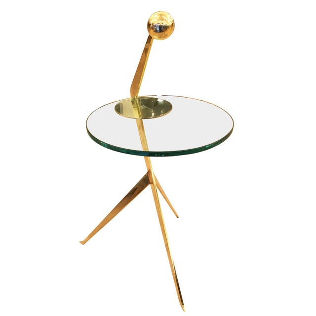 Cantilever side table designed by Gaspare Asaro for formA featuring a thick glass top on a polished brass frame. The brass...