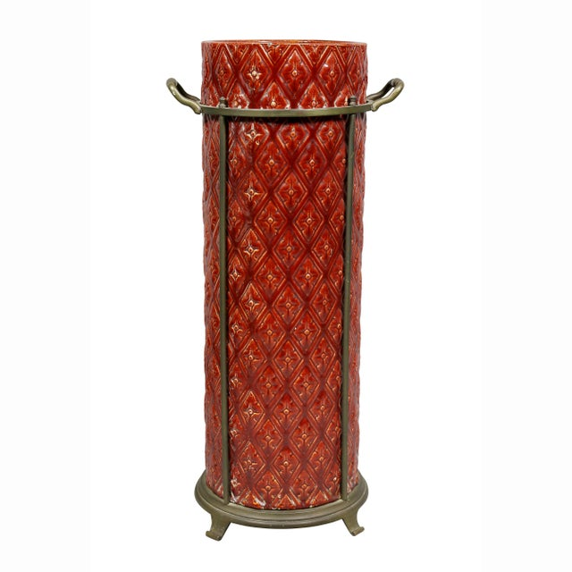 Red glaze with trellis pattern set within a brass holder with handles. Signed on base. Provenance; Dodo Dorrance Hamilton.