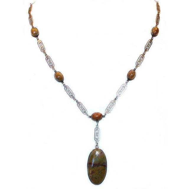 A rarely seen 1910/20's Arts and Crafts sterling openwork link necklace with bezel-set oval agate cabochons and...