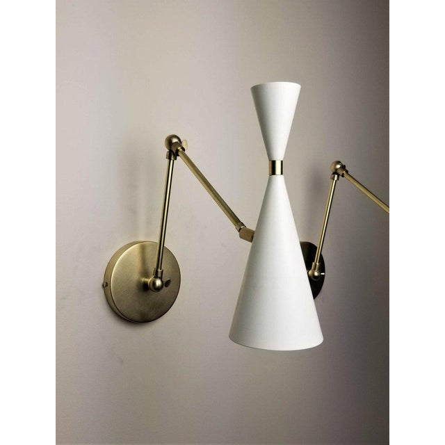 The Monolith sconce or wall-mount reading light with articulating arm and moveable head shown in satin enamel fabricated...