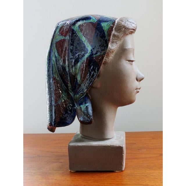 Partly glazed mid century stoneware sculpture of a young girl with scarf made by Johannes Hedegaard for Royal Copenhagen,...