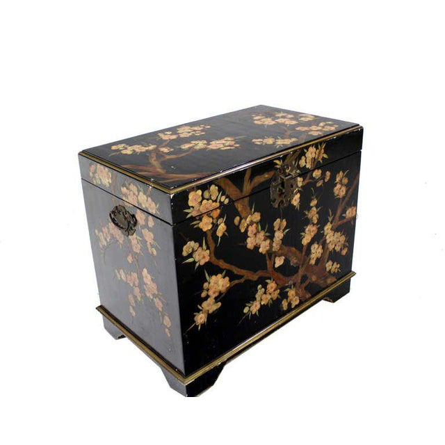 Very nicely painted vintage Oriental chest equipped with an electric up and down bottom/shelf.