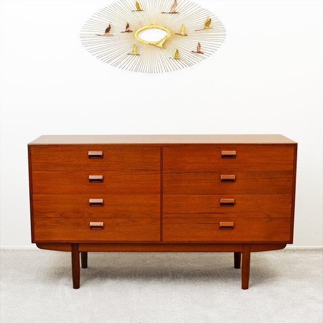 An impeccably clean 8 Drawer Teak Dresser designed by Borge Mogensen for Soborg Mobler in Excellent Vintage Condition....