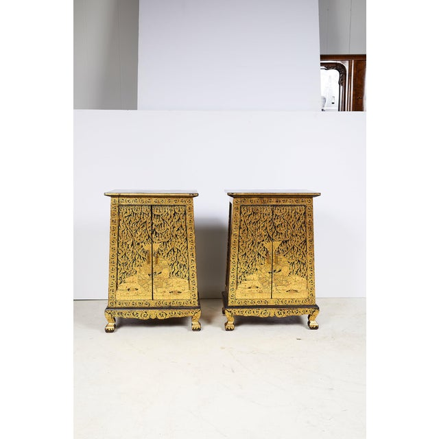 An elegant pair of mid 20th century Thai manuscript cabinets, with a tapered teak wood body and slightly cantilevered top,...