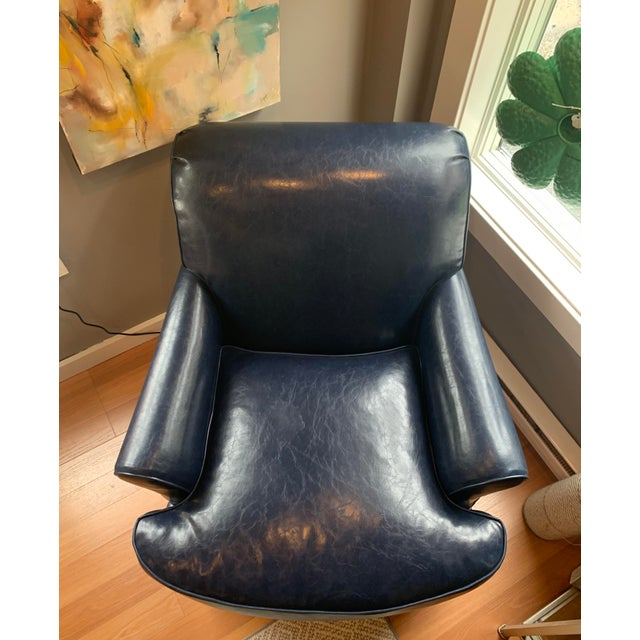This lovely faux-leather chair adds a splash of blue to liven any space. At the intersection of comfort and elegance, this...