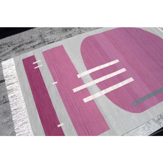 This rug is a one of a kind heirloom piece. Inspired by light and movement, the asymmetrical design is meant to enhance...