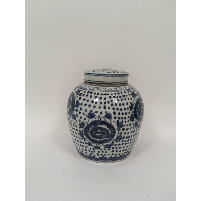 Blue and white porcelain peony ginger jar with dots.