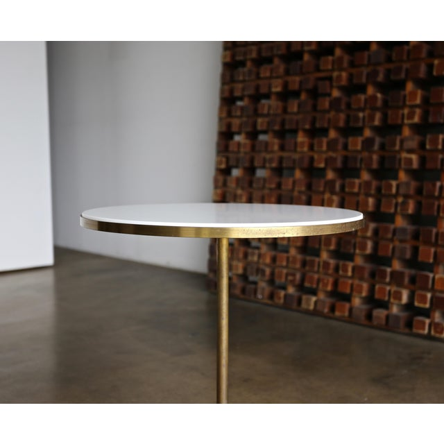 """The """"Cigarette"""" occasional table by Paul McCobb for Directional. This example retains its original patina to the brass."""