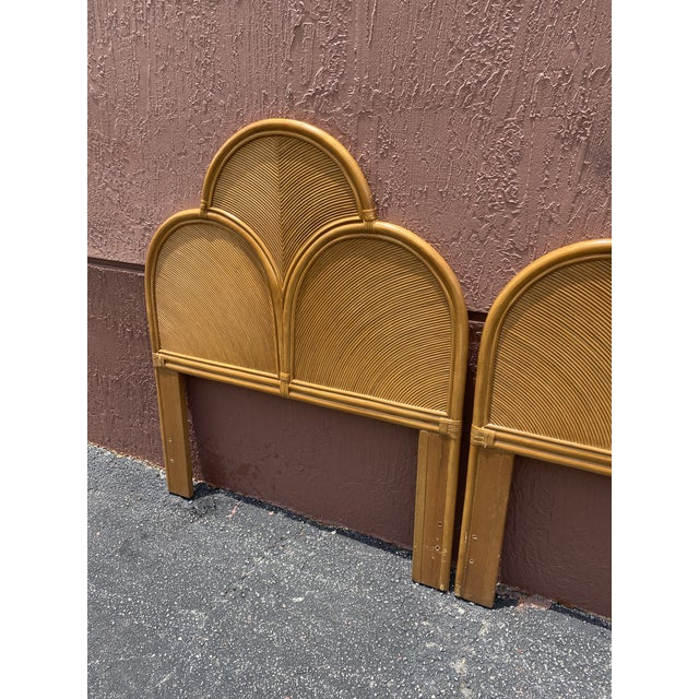 Fabulous pair of pencil reed headboards. Gorgeous pattern work creates these really special pieces. Acquired from a Palm...