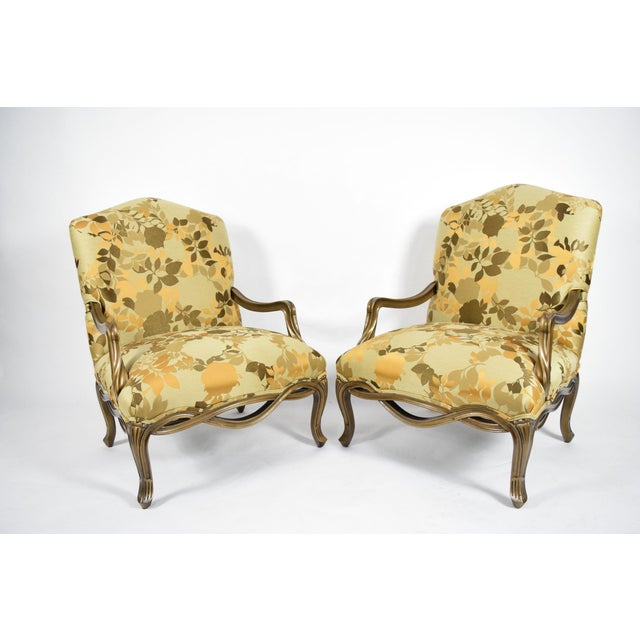 """This is a custom designed pair of Louis XVI style lounge chairs with oversized seats upholstered in Rubelli """"Grace""""..."""