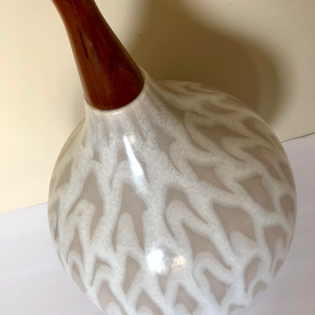 """Mid century Danish beige drip glaze pottery and teak table lamp. Measures 24"""" to the socket."""