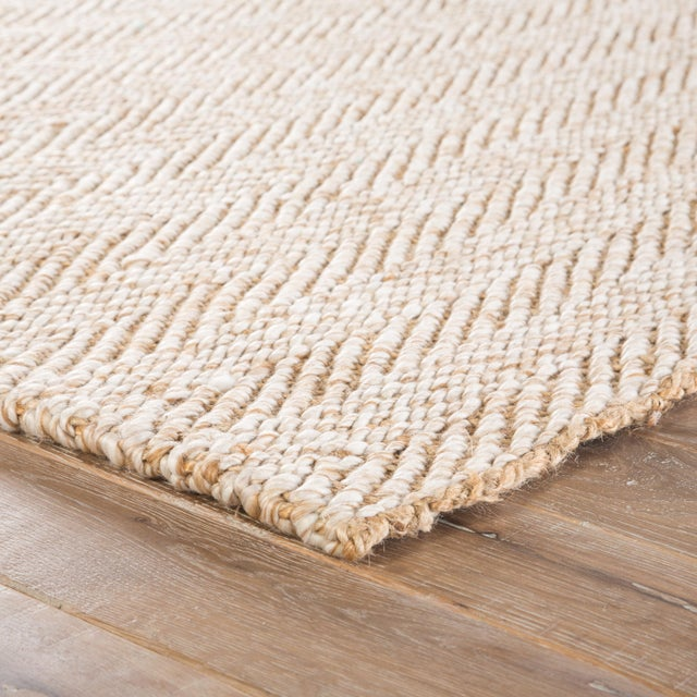 Inviting texture and eco-friendly appeal meet to form the Roland collection. Woven of jute and recycled materials, the...