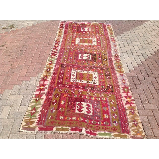 This beautiful vintage handwoven kilim is in fabulous shape. It is approximately 80 years old, handmade of very fine...
