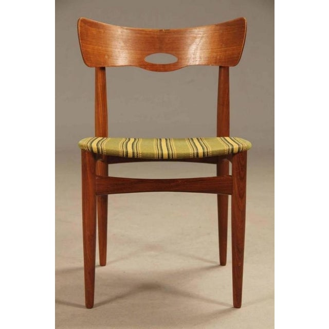 These vintage chairs from the 1960s were produced by Bramin in Denmark. They have curved back rest wit ha small copper...