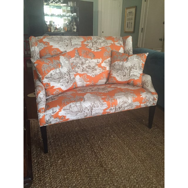 Custom upholstered settee in Manuel Canovas Tortuga in saffron. Legs in a black finish.