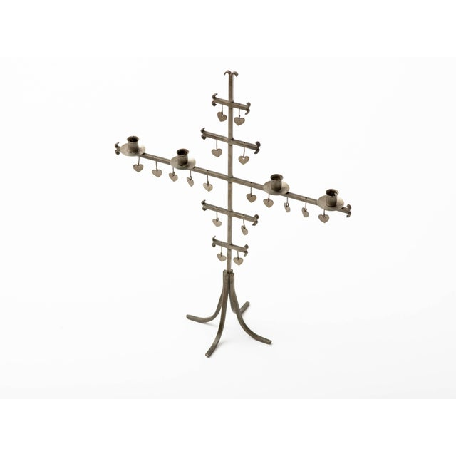 Midcentury Swedish hand-wrought steel candelabra with four candleholders. 18 cut steel hearts adorn frame. Signed with...