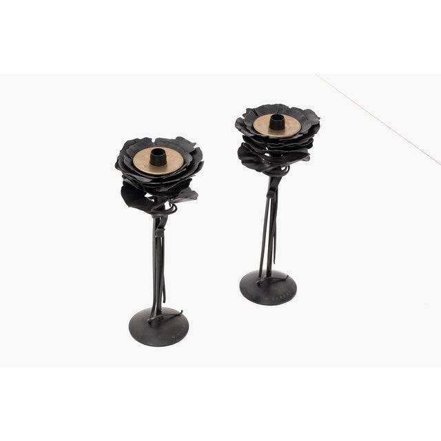 A pair of blossom candle holders by Albert Paley Studio. Forged and blackened steel with brass. Signed and dated [Albert...