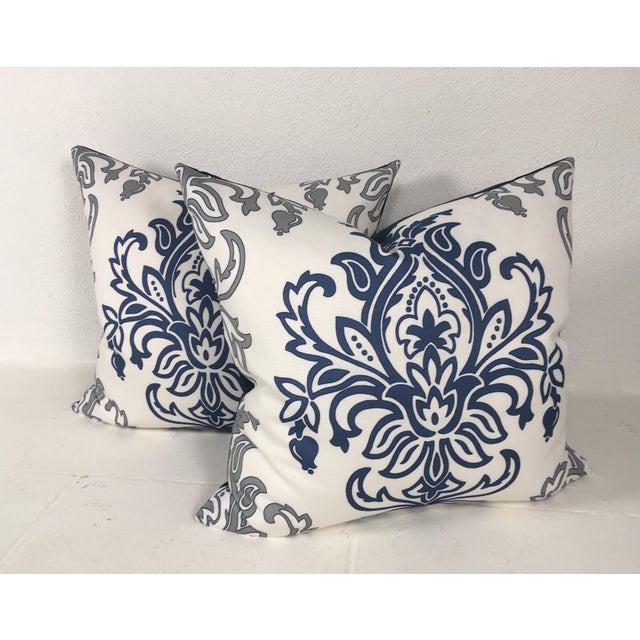 This is a pair of large summertime blue and white cotton print pillows with a medallion motif, backed with a navy blue...