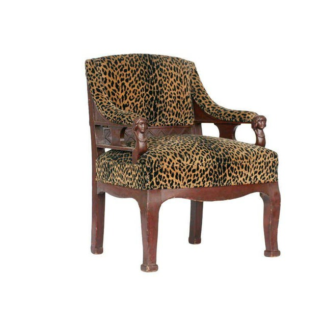 Vintage pair of hand-carved Empire style chair with leopard print seat tops featuring two carved female busts on each arm.