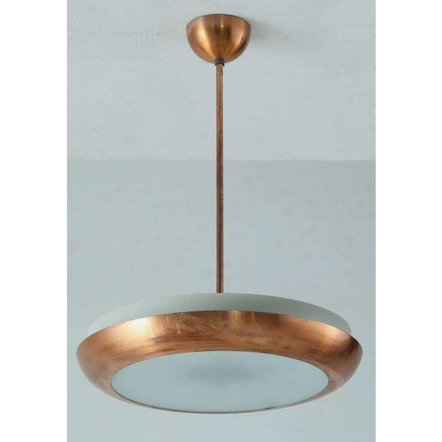 A copper coated ring with a glass diffuser plate and metal inner ring. The lamp holds six porcelain E27 lamp holders....