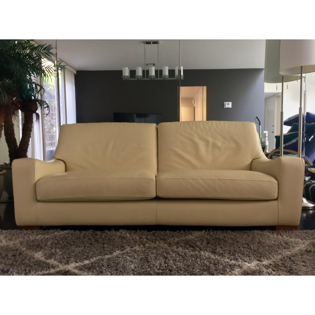 Roche Bobois sofa with foldable sleeper for sale. In a white/tan/beige color. The sofa itself is in very good condition....
