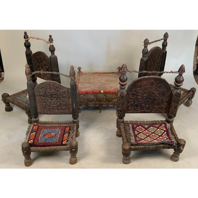 An amazing set of four antique 19th century tribal bedouin chairs from northern Pakistan, with amazing details and the...