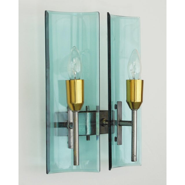 Vintage Italian wall lights with two curved and beveled rectangular shaped glasses / Designed by Cristal Arte, circa...
