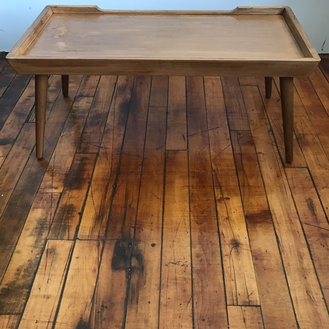 Vintage modern lightweight coffee table. Surface is somewhat distressed, can use refinishing.