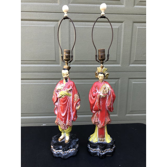 Charming pair of table lamps depicting a happy Asian couple. Carved plaster. Ivory resin finials. Flowing robes, great...