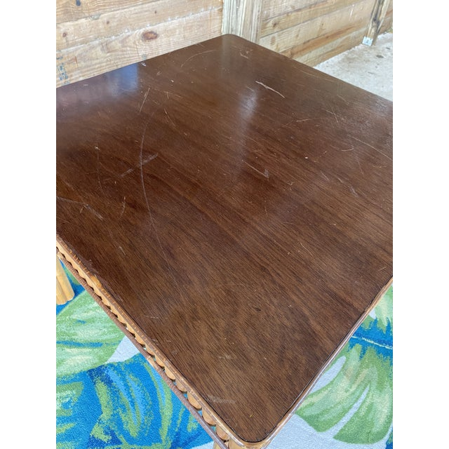 Fabulous vintage split bamboo table in as found vintage condition. All four legs are bamboo along with the sides with a...
