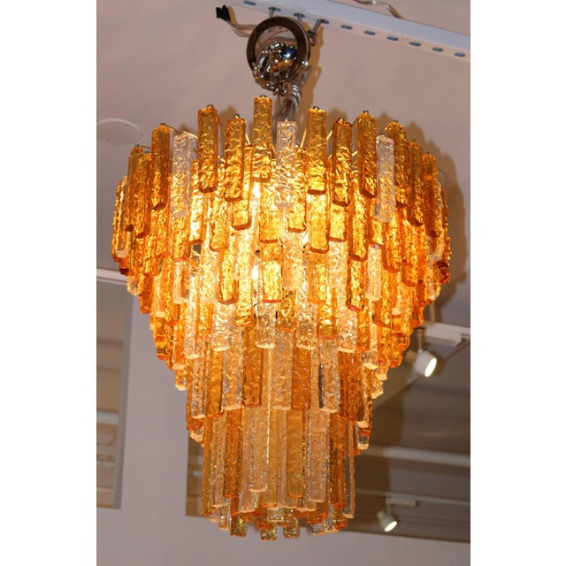 Stunning large 1960s Venini clear and amber glass chandelier. Newly professionally rewired and ready to use. Frame and...